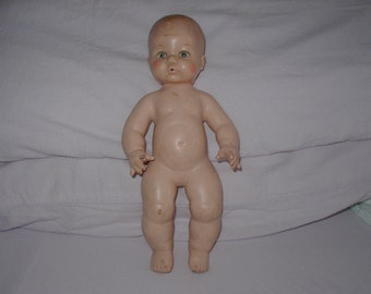 15 inch tall rubber composition doll.  With an adorable face and rosy cheeks.  From the 50's