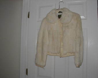Ladies rabbit fur jacket from the early 1970's in a size medium.