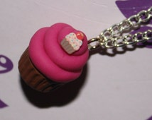 Adorable Pink Frosting Cupcake Necklace With Tiny Cupcake Topping.