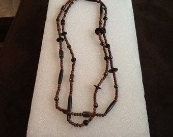 "Very nice vintage beaded wood and glass necklace 48"" long"