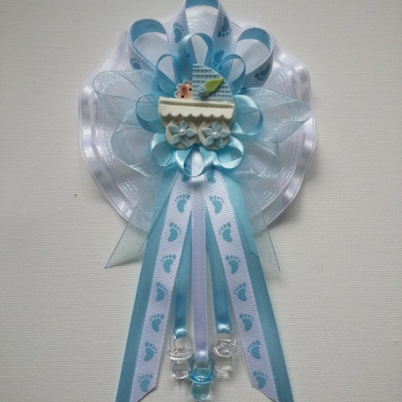 mommy baby shower corsage in blue and white with footprint printed
