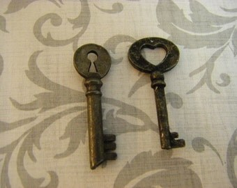 2  Rustic Skeleton Keys, primitive,  rustic ,blackened,  aged key charms, USAcharms