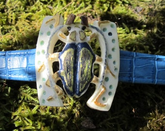 Bracelet of blue leather with its golden beetle