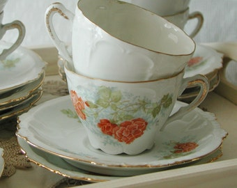 Antique fine bone china tea cup and saucer with Scalloped Edges and pretty orange flowers. Very old and elegant  teacups and saucers.