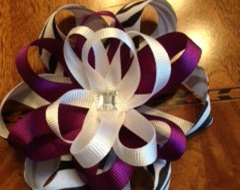 Three ribbon bow with jewel or flower