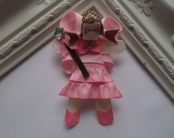 The girl in Pink Ribbon Sculpture Hair Clip.