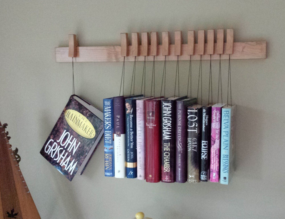 Book Sling Rack Invisable Book Shelf A Very Unique Way To