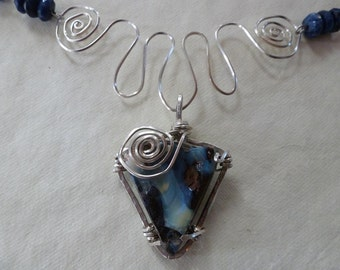 Australian Boulder Opal wire wrapped in Argentium silver on hand forged silver spiraled squiggle and handmade sodalite and silver chain