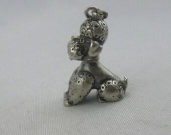 Sitting poodle: Ancient silver pendant / charm. Vintage