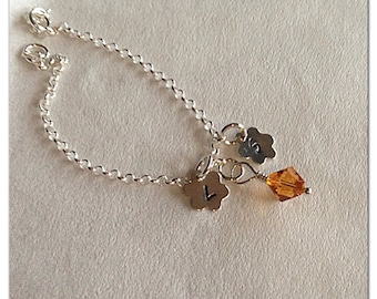 Sterling silver sisters bracelet with Swarovski crystal and charms.