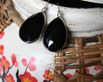 Siilver accented large black oval pendant