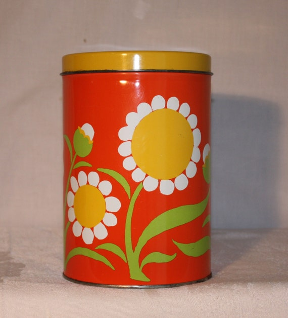 Bright orange tin canister with large white and yellow flowers, 70s, J. L. Clark