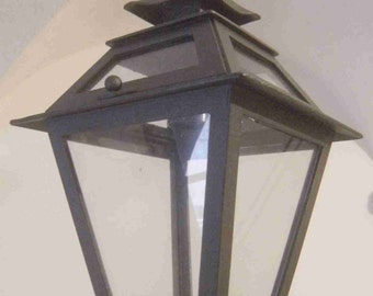 Lantern for illumination in heavy iron, to hang suspended with glass, for rustic, arcade, gardens.