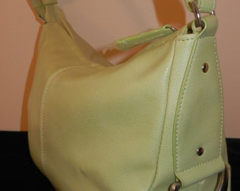 "Vintage Handbag in NEW condition Never used. Measures 12"" X 8"" X 4""."