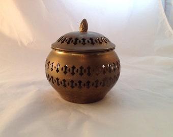 Decorative round brass trinket or potpourri box with lid