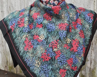Vintage Ostinelli black silk scarf with red blue and green abstract floral motives