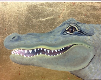 Gold leaf canvas with painting of smiling alligator