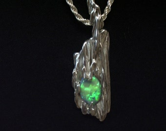 BRIGHT GREEN FLASH opal on broom cast silver pendant.