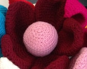 Julie - Giant Crochet Flower with a soft pink centre surrounded by crimson petals and accentuated by dark green stem