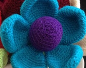 Jessica - Giant Crochet Flower with a rich purple centre surrounded by delightful blue petals and accentuated by apple green stem