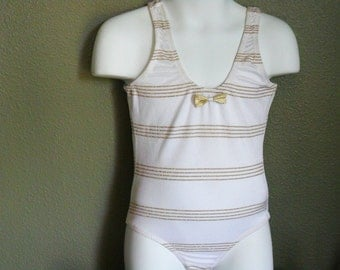 one piece girl's swimsuit-White with gold accent-Size: 6, 7, 8, 12 The size runs small, please order at least 2 size up!!!