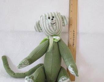 MR. GREEN; A happy green monkey.