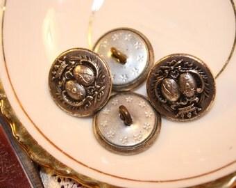 Four metal VINTAGE buttons