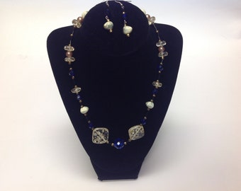 Handmade blue and beige glass bead necklace with matching earrings