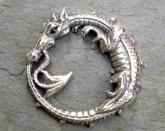Ouroboros Dragon necklace, silver and sapphire pendant.
