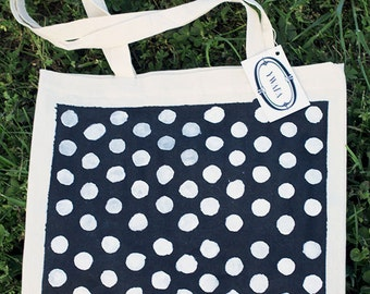 white dots on black tote bag
