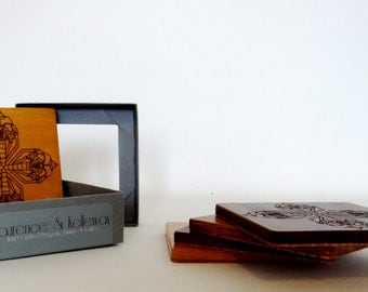 Solid wooden coasters featuring laser cut 'Loco' Design.