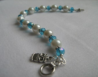 White Faux Pearl and Blue Crystal Bracelet