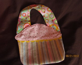 cupcake shaped bib with circles and stripes
