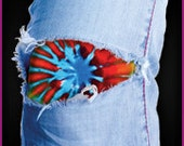 EASILY fix your distressed, holey jeans with a starburst tie dye patch.