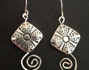 Silver earrings with hammered swirls