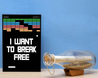 I want to break free. Black with white writing in a eco friendly box frame