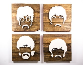 handcrafted the beatles face silhouettes on salvaged wood
