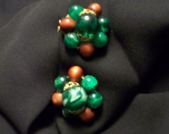 Vintage green swirled glass bead, and wood bead,brass backing