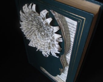 Upcycled book sculpture with face and folded paper flower.  Homer's Illiad.
