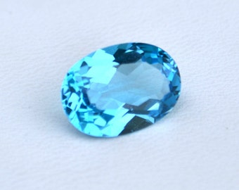 10x14 mm OVAL natural genuine SWISS blue topaz top cut  faceted gemstone....