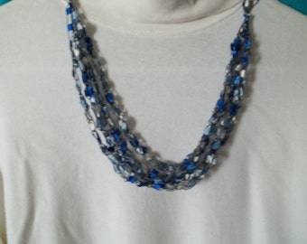 Blue crochet necklace.