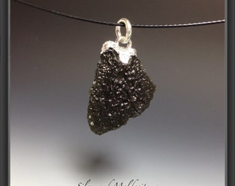 Moldavite with silver platted edge