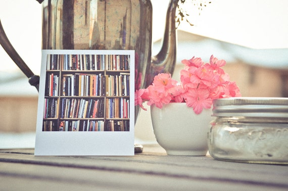 Cozy Polaroid-size print of bookcase, well-stocked