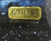 OTHER hand-stamped brass pin