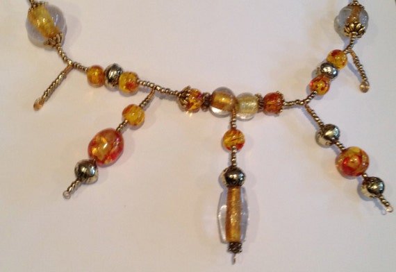Amber, gold and yellow beaded necklace and earrings set