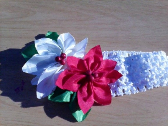 Red and White Pointsettia Headband on a white crochet elastic band