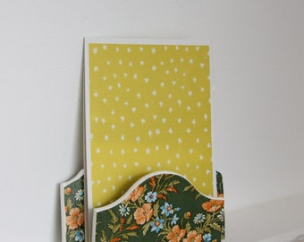 Letter holder with green vintage wallpaper with flowers