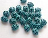 Glass ladybug beads, ladybird beads, turquoise 9x7mm pack of 20
