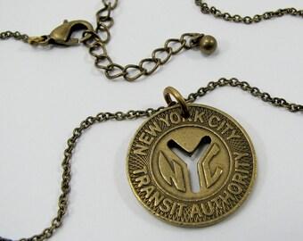 """NYC subway token necklace with """"Y"""" cutout"""
