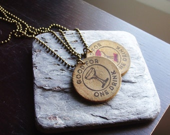 Vintage token necklace, good for one drink